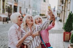 Free Three Funny Old Ladies Making Selfie Together Royalty Free Stock Image - 137700496