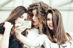Three funny pretty girls make self photo Stock Photos
