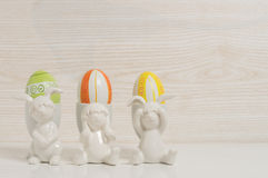 Three funny rabbits with easter eggs Royalty Free Stock Photo