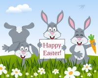 Three Funny Rabbits Wishing Happy Easter Stock Photo