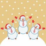 Three funny snowmen happy Stock Images