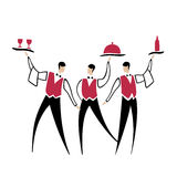 Three funny waiters Stock Image