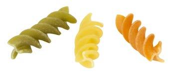 Three fusilli dry pasta Royalty Free Stock Image