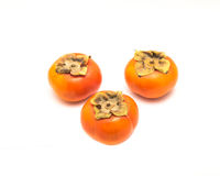 Three Fuyu persimmon isolated Stock Image