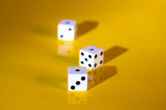 Three game dice Stock Images