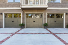 Three Garage door with windows Royalty Free Stock Photo