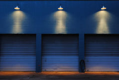 Three Garage Doors at Night w Outdoor Lighting Stock Photography