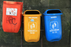 Three garbage recycle bin outdoor rubbish trash can color orange yellow blue Royalty Free Stock Photography