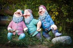 Three Garden Gnomes. Three colourful old garden gnomes royalty free stock photo