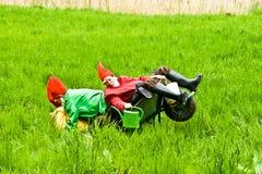 Three garden gnomes enjoy children Stock Images