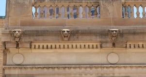 Three gargoyles on concrete building Stock Image