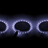 Three gas heaters. Three hot burning gas cookers with blue power Royalty Free Stock Photos