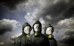 Three gas masks. Survival theme. Royalty Free Stock Images