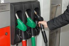 Three gas pump nozzles Royalty Free Stock Image