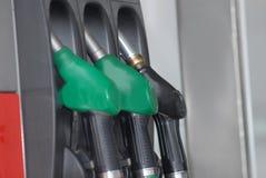 Three gas pump nozzles Stock Photo
