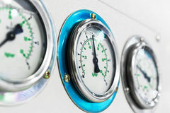 Three gauge on the dashboard of industrial compressor. Royalty Free Stock Image