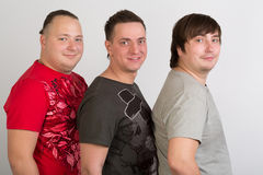 Three gay men in T-shirts Royalty Free Stock Photo