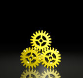 Three Gear Pyramid. Pyramid of three (3) gears linked together on a black background. Computer-generated image stock illustration