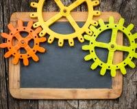 Three gear wheels on wood Royalty Free Stock Photo