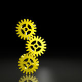 Three Gears Balanced Together. Three gears link together against a black background. Computer-generated image royalty free illustration