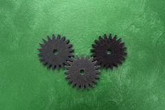 Three gears on green Royalty Free Stock Photos