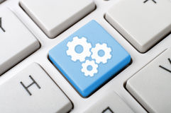Three gears key on keyboard Stock Photography