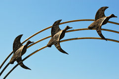 Three Geese Flying. A statue of three geese flying through the sky Stock Photos