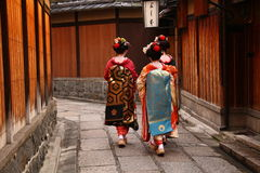 Three geishas Stock Images