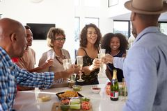 Three generation African American  family celebrating together make a toast with champagne,close up stock images