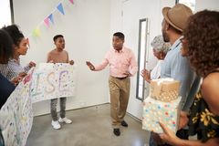 Three generation African American  family preparing to make a surprise party welcome, full length stock photo