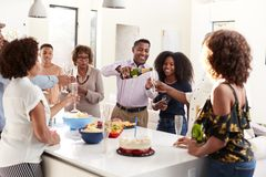 Three generation African American  family raising glasses to make a toast during a celebration at home stock image