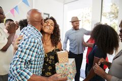 Three generation African American  family welcoming guests in the doorway of their home,close up. Three generation black family welcoming guests in the doorway royalty free stock photo