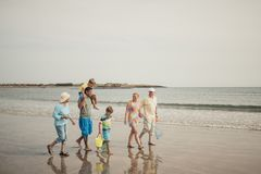 Three Generation Family on a Beach Stock Photography