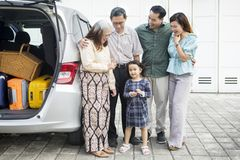 Three generation family with car in the garage stock images