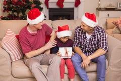 Three generation family celebrating christmas Stock Photography