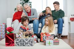 Three Generation Family With Christmas Presents Stock Images