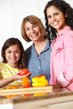 Three generation family cooking Royalty Free Stock Photos