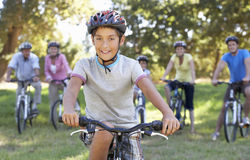 Three Generation Family On Cycle Ride In Countryside Stock Photo
