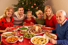 Three Generation Family Enjoying Christmas. Meal At Home stock photography