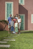 Three Generation Family In Front Of House Stock Image
