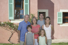 Three Generation Family In Front Of House Royalty Free Stock Images