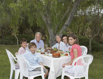 Three Generation Family At Garden Dining Table Stock Photos