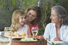 Three Generation Family At Garden Table Stock Images