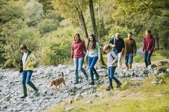 Three Generation Family Hiking through the Lake District. Three generation family are hiking together through the Lake District with their pet dog royalty free stock photography