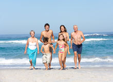 Three Generation Family On Holiday On Beach stock photography