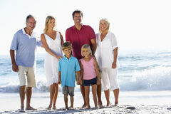 Three Generation Family On Holiday Walking On Beach Stock Photography