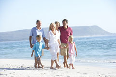 Three Generation Family On Holiday Walking On Beach Royalty Free Stock Image