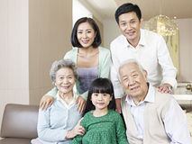 Three-generation family. Home portrait of a three-generation asian family stock photos