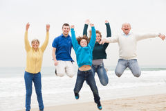 Three generation family jumping in air Stock Photography