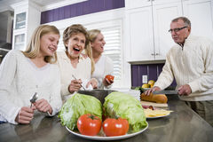Three generation family in kitchen cooking lunch Stock Photo